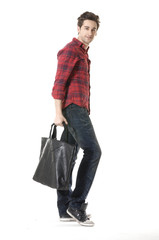 Young Casual man walking isolated on white background