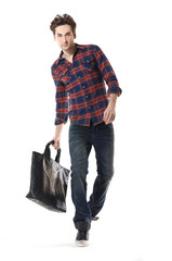 Young Casual man with bag walking posing in the studio