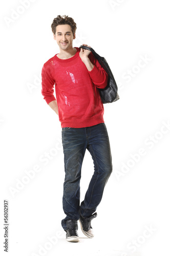Young Casual man walking posing in the studio