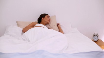 Stressed beautiful woman waking up too late