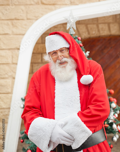 Santa Claus Standing Outside House