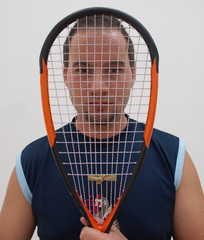 Squash player with racket.