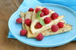 pancakes (crepes) with raspberries and mint