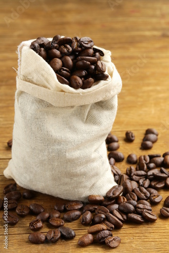 roasted coffee beans on a wooden table