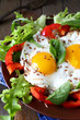 fried eggs with vegetables for breakfast