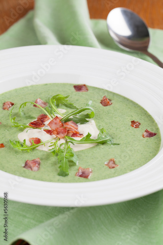 Arugula cream soup with sour cream and bacon