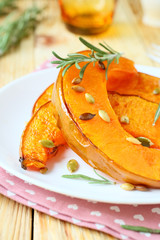 slices of roasted pumpkin with rosemary