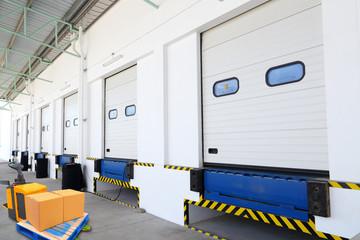 Warehouse bay door with forklift car