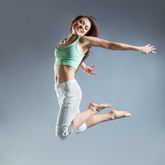 beauty girl dance on grey background