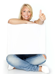 Woman with message board shows thumb up
