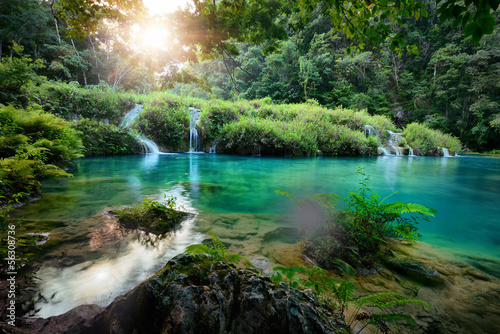 Tuinposter Watervallen Cascades National Park in Guatemala Semuc Champey at sunset