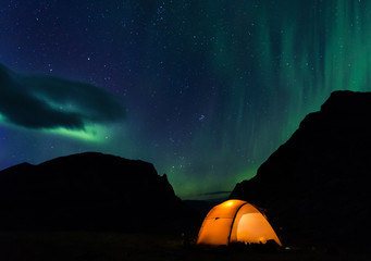 Illuminated Tent with northern lights in Lapland