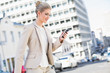 Smiling gorgeous businesswoman text messaging