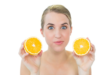 Funny attractive blonde holding orange slices