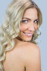 Smiling gorgeous blond model posing