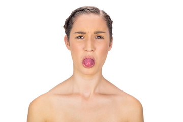 Healthy woman sticking her tongue out