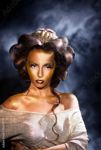 Coloring. Portrait of Styled Woman with Golden Colored Skin
