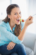 Cheerful attractive woman eating healthy salad