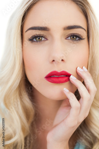 Portrait of a cute blonde model looking at camera