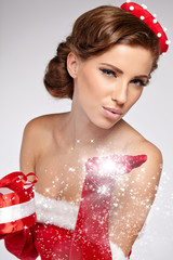 Christmas vintage brunette with gift box, isolated on grey. Fash