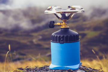Camping stove on a rock in the mountains