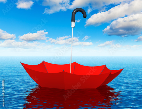 Red floating umbrella in the sea