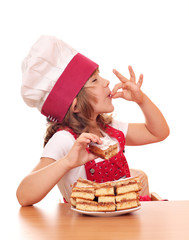 happy little girl cook with apple cakes