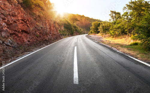 Empty rural asphalt highway perspective