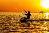 Silhouettes of a windsurfers