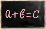 a+b=c handwritten with white chalk on a blackboard