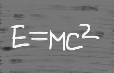 E=mc2 handwritten with chalk on a blackboard