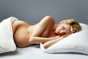 Beautiful pregnant woman in bed