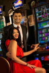 Beautiful young couple near slot machine