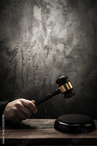 Judge's holding wooden hammer