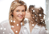 happy daughter kisses her mother