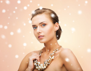 woman wearing pearl statement necklace