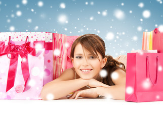 happy girl with shopping or gift bags