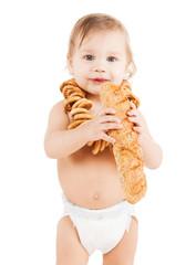 cute todler eating long bread
