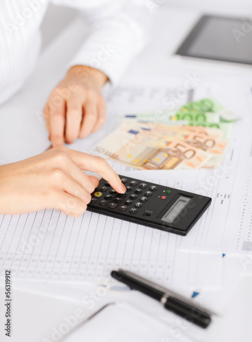 woman hand with calculator and euro money