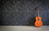 Fototapety Acoustic guitar in empty room background