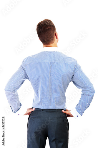 business man from the back - looking at something over a white b