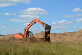 The excavator works at soil relocation poster