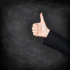 Thumbs up hand on blackboard / chalkboard