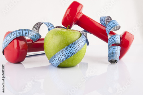 Apple, measurement tape and dumbbell 3