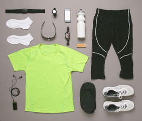 Running equipment man on grey background.