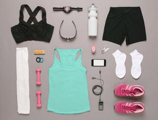 Running equipment woman on grey background.