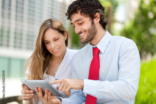 Businesspeople using a tablet