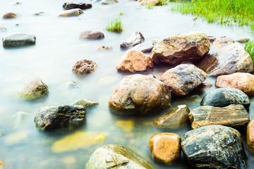 Rocks on the coastline under morning sunlight