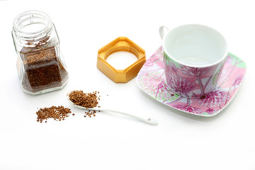 Porcelain cup and jar with instant coffee