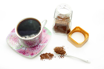 Open glass and cup with instant coffee